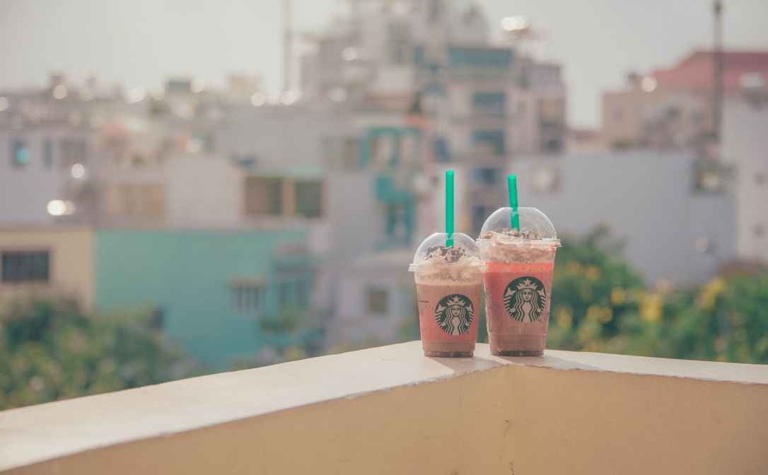close up photography of two starbucks disposable cups